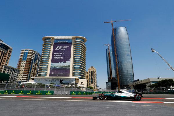 Baku City Circuit, Baku, Azerbaijan. Friday 23 June 2017. Valtteri Bottas, Mercedes F1 W08 EQ Power+, drives in front of the Baku skyline. World Copyright: Steven Tee/LAT Images ref: Digital Image _O3I0663