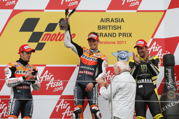 British Grand Prix. Silverstone, England. 10th-12th June 2011. Andrea Dovizioso, Casey Stoner, Honda, with the winner's trophy, John Surtees  and Colin Edwards, Yamaha, on the podium. World Copyright: Kevin Wood/LAT Photographic. ref: Digital Image