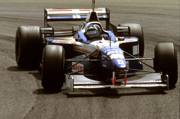Magny-Cours, France.28-30 June 1996.Damon Hill (Williams FW18 Renault) 1st position at Lycee.Ref-96 FRA 08.World Copyright - LAT Photographic