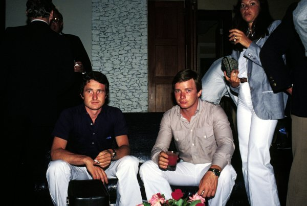(L to R): Race retiree Patrick Depailler (FRA) Tyrrell enjoys a cigarette at a party as team mate Didier Pironi (FRA), who scored his first World Championship point in only his second GP with a sixth place finish, relaxes with a drink. Brazilian Grand Prix, Rd 2, Rio de Janeiro, Brazil, 29 January 1978.