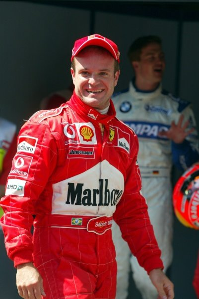 Pole sitter Rubens Barrichello (BRA) Ferrari celebrates.