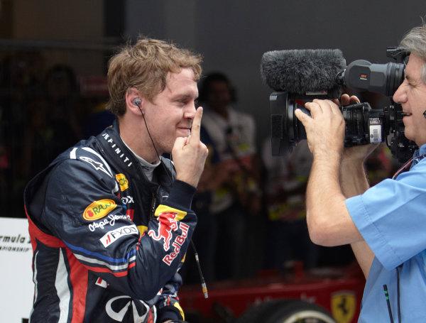 Buddh International Circuit, New Delhi, India. 30th October 2011. Sebastian Vettel, Red Bull Racing RB7 Renault, 1st position, celebrates in Parc Ferme. Portrait. Finish.  World Copyright:Steve Etherington/LAT Photographic ref: Digital Image SNE29692