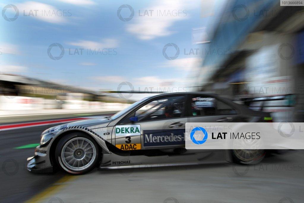 Bruno Spengler (CDN), Mercedes-Benz Bank AMG C-Klasse (2009) exits his pit Ref: Digital Image dne1117se527