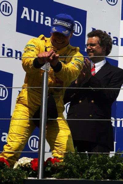 Race winner Christian Menzel (GER) celebrates on the podium. Porsche Supercup, Rd 5, Nurburgring, Germany, 29 May 2005. DIGITAL IMAGE