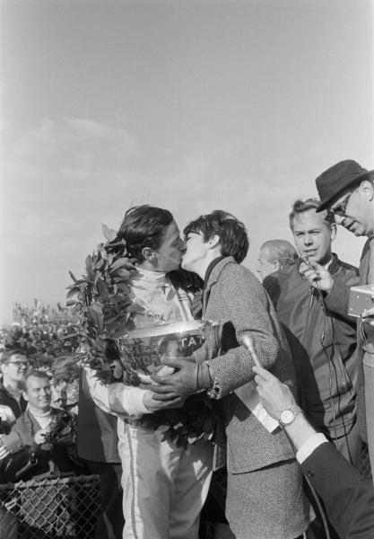 Race winner Jim Clark (GBR) embracing Miss US Grand Prix. 