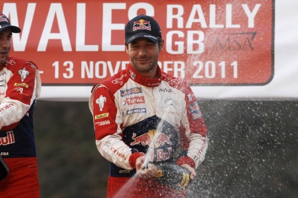Sebastien Loeb (FRA) celebrates his 8th World Rally Championship on the podium in Cardiff Castle.