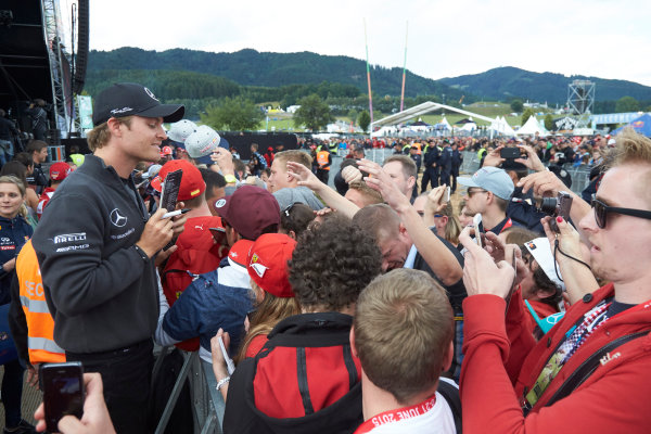 Red Bull Ring, Spielberg, Austria. Saturday 20 June 2015. Nico Rosberg, Mercedes AMG, signs autographs for fans. World Copyright: Steve Etherington/LAT Photographic. ref: Digital Image SNE24305