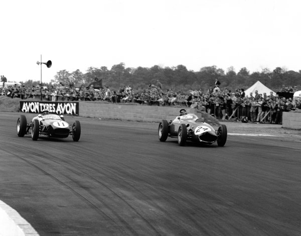 1960 International Trophy. Silverstone, England. 14th May 1960. Alan Stacey (Lotus 18 - Climax), 4th position, passes Cliff Alison (Ferrari 246/60), 8th position, action.  World Copyright: LAT Photographic. Ref: 6317.