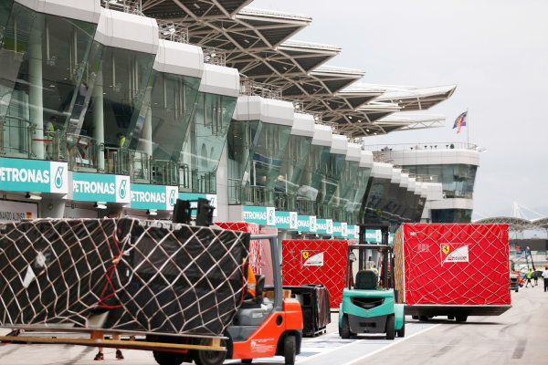 Sepang International Circuit, Sepang, Kuala Lumpur, Malaysia. Sunday 29 March 2015. The Ferrari team pack their equipment after a successful race weekend. World Copyright: Alastair Staley/LAT Photographic. ref: Digital Image _R6T6490