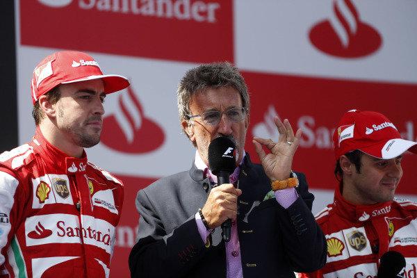 Circuit de Catalunya, Barcelona, Spain 12th May 2013 Eddie Jordan, BBC F1 TV Pundit, interviews Fernando Alonso, Ferrari, 1st position, on the podium. Photo: Andrew Ferraro/LAT Photographic ref: Digital Image _79P6154
