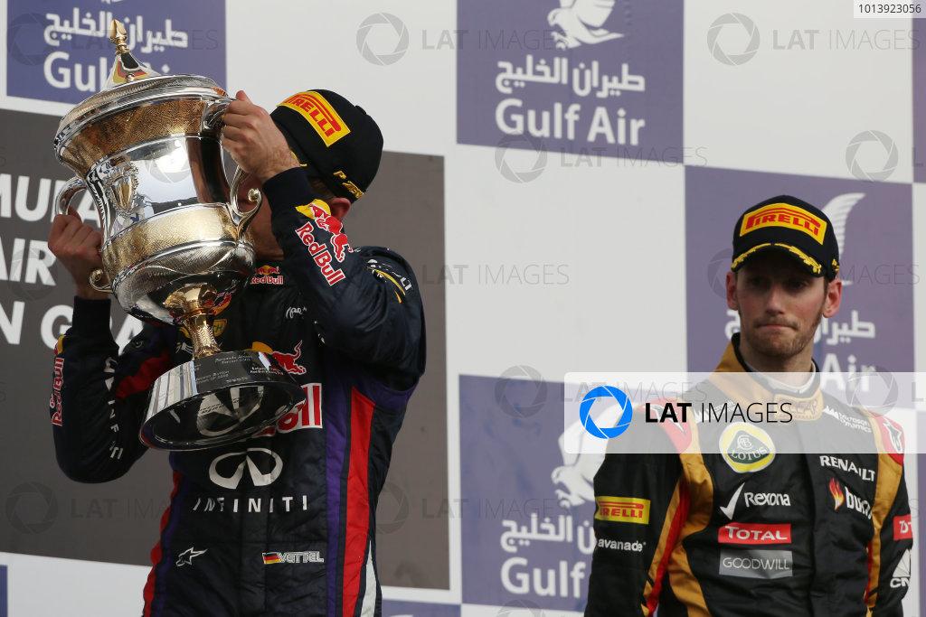 Bahrain International Circuit, Sakhir, Bahrain Sunday 21st April 2013 Sebastian Vettel, Red Bull Racing, 1st position, kisses his trophy. World Copyright: Andy Hone/LAT Photographic ref: Digital Image HONZ3029