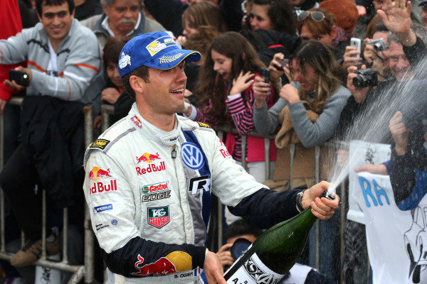 Sebastien Ogier (FRA) Volkswagen celebrates second place on the podium with the champagne. FIA World Rally Championship, Rd5, Rally Argentina, Day Three, Cordoba-Villa Carlos Paz, Argentina, 11 May 2014.