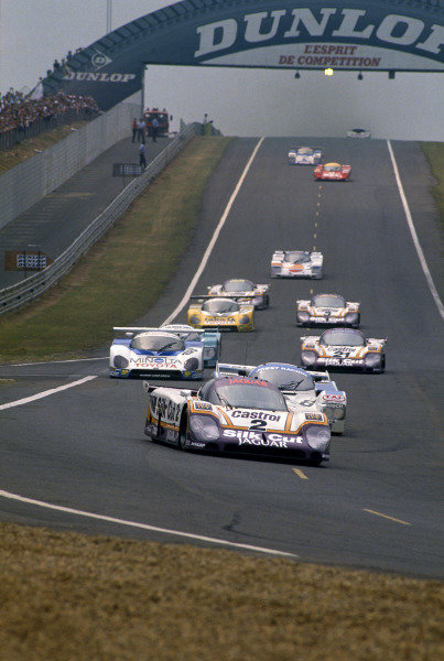 Le Mans, France. 11th - 12th June 1988 Jan Lammers/Johnny Dumfries/Andy Wallace Jaguar XJR-9 LM, 1st position, lead the field at the start, action. World Copyright: LAT Photographic ref: 88LM12