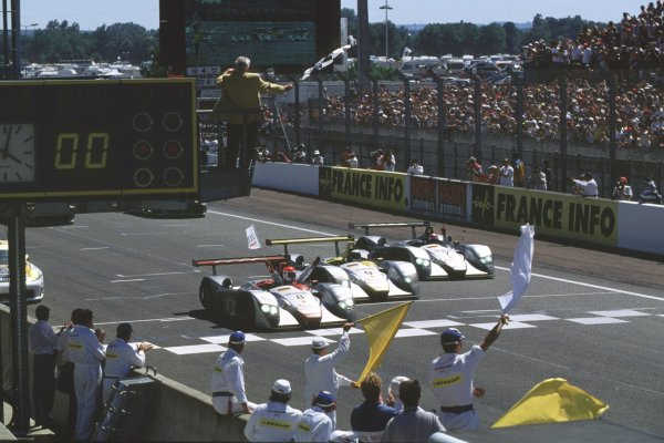 2000 Le Mans 24 Hours. Le Mans, France. 17-18 June 2000. Emanuele Pirro (Audi R8) leads his team-mates across the line in formation after finishing in 1st, 2nd and 3rd positions. World Copyright: LAT Photographic. Ref:  Colour Transparency