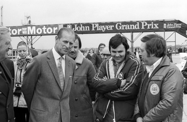 HRH The Duke of Edinburgh (Left) talks with Alan Jones (AUS) Hesketh, who finished the race in seventh position.Non Championship Formula One, XXVII Daily Express BRDC International Trophy, Silverstone, England, 13 April 1975.