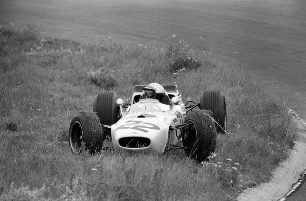 Richie Ginther, Honda RA272, parks up on the grass.