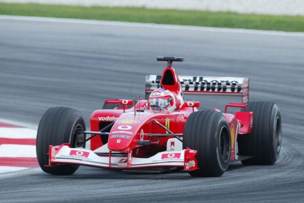 2003 Malaysian Grand Prix. Sepang, Kuala Lumpur, Malaysia.21-23 March 2003.Rubens Barrichello (Ferrari F2002) 2nd position.World Copyright - LAT Photographic ref: Digital Image Only