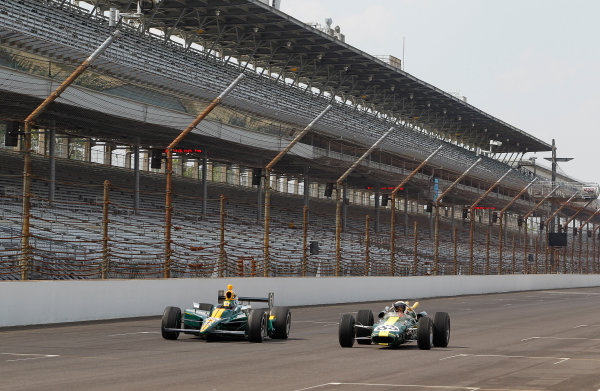 15-21 May, 2010, Indianapolis, Indiana, USATakuma Sato with his IRL rookie entry and Jimmy Vasser in Jim Clark's 1963 rookie Lotus-Ford on the main straight of the Indianapolis Motor Speedway©2010, Michael Levitt, USALAT Photographic