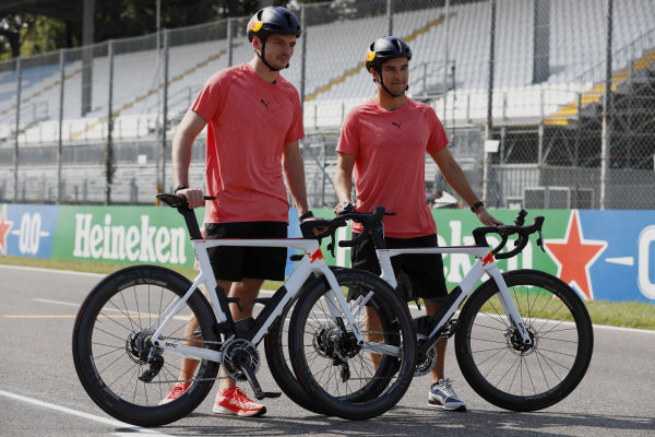 Max Verstappen, Red Bull Racing, and Sergio Perez, Red Bull Racing, with their bicycles on track
