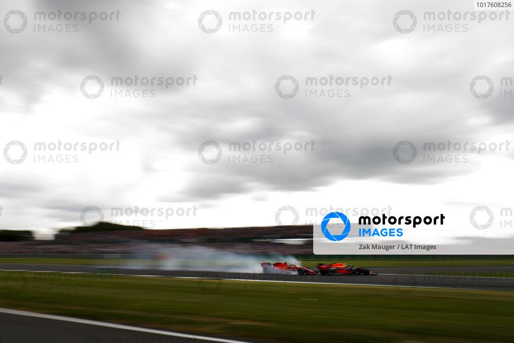 Sebastian Vettel, Ferrari locks up and runs into the back of Max Verstappen, Red Bull Racing RB15