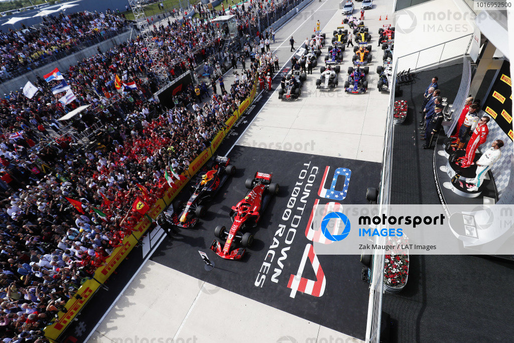 Kimi Raikkonen, Ferrari SF71H, celebrates on the podium with Max Verstappen, Red Bull Racing RB14, and Lewis Hamilton, Mercedes AMG F1 W09 EQ Power+