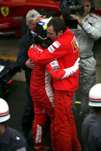 Interlagos, Sao Paulo, Brazil2nd November 2008Felipe Massa, Ferrari F2008, 1st position, is consoled by Stefano Domenicali, Sporting Director, Ferrari. Portrait. Helmets. World Copyright: Andrew Ferraro/LAT Photographicref: Digital Image VY9E0133
