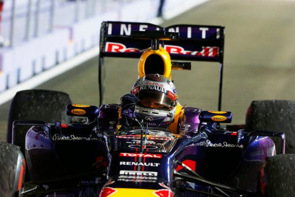 Marina Bay Circuit, Singapore. Sunday 22nd September 2013.  Sebastian Vettel, Red Bull RB9 Renault, celebrates.  World Copyright: Charles Coates/LAT Photographic. ref: Digital Image _N7T7753