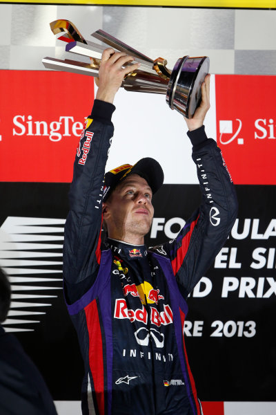 Marina Bay Circuit, Singapore. Sunday 22nd September 2013.  Sebastian Vettel, Red Bull Racing, celebrates on the podium.  World Copyright: Glenn Dunbar/LAT Photographic. ref: Digital Image _89P1296
