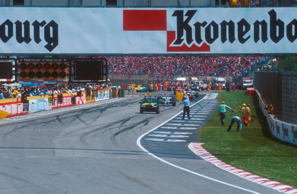 Imola, Italy.29/4-1/5 1994.Ayrton Senna (Williams FW16 Renault) leads the rest of the field behind the safety car which was brought out after the Lehto/Lamy startline shunt.Ref-94 SM 39.World Copyright - LAT Photographic