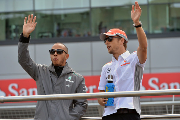 Lewis Hamilton (GBR) Mercedes AMG F1 and Jenson Button (GBR) McLaren on the drivers parade.Formula One World Championship, Rd8, British Grand Prix, Race Day, Silverstone, England, Sunday 30 June 2013.