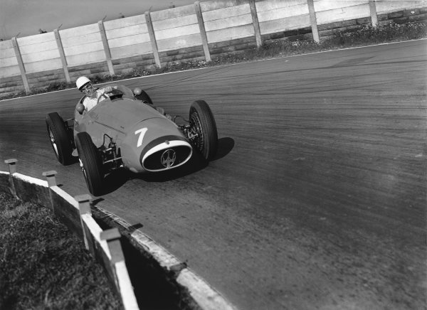 Aintree, England. 2nd October 1954.Stirling Moss (Maserati 250F), 1st position, action. World Copyright: LAT PhotographicRef:  Autocar Glass Plate C41256.
