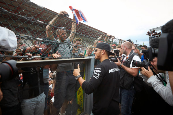 Spa-Francorchamps, Spa, Belgium. Sunday 23 August 2015. Lewis Hamilton, Mercedes AMG gives a thumbs up to the fans after winning the race. World Copyright: Steve Etherington/LAT Photographic ref: Digital Image SNE22811