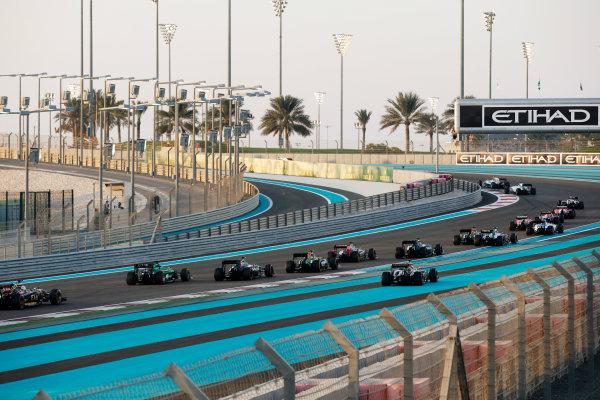 Yas Marina Circuit, Abu Dhabi, United Arab Emirates. Sunday 23 November 2014. Sergio Perez, Force India VJM07 Mercedes, runs wide as the pack heads though the first corner. World Copyright: Glenn Dunbar/LAT Photographic. ref: Digital Image _W2Q6364