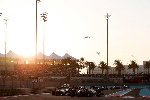 Yas Marina Circuit, Abu Dhabi, United Arab Emirates. Sunday 23 November 2014. Sergio Perez, Force India VJM07 Mercedes, leads Esteban Gutierrez, Sauber C33 Ferrari. World Copyright: Steven Tee/LAT Photographic. ref: Digital Image _L4R7112