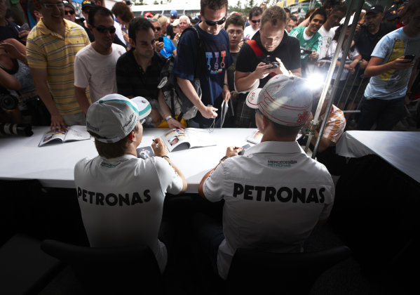 Circuit Gilles Villeneuve, Montreal, Canada 9th June 2011 Nico Rosberg, and team mate Michael Schumacher, Mercedes GP W02. Sign autographs for fans. Portrait.  World Copyright: Steve Etherington/LAT Photographic ref: Digital Image SNE27678