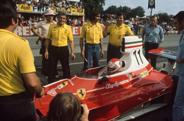 Monza, Italy. 5 - 7 September 1975.Clay Regazzoni (Ferrari 312T), 1st position, on the starting grid, portrait. World Copyright: LAT Photographic.Ref:  75ITA02.