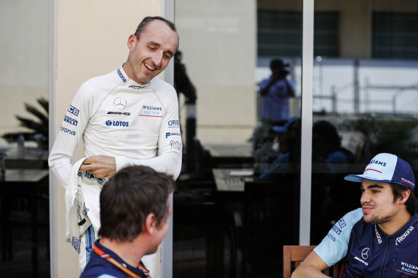 Robert Kubica, Williams Racing, puts on his racing suit whilst talking to Lance Stroll, Williams Racing and Rob Smedley, Head of Vehicle Performance, Williams Racing