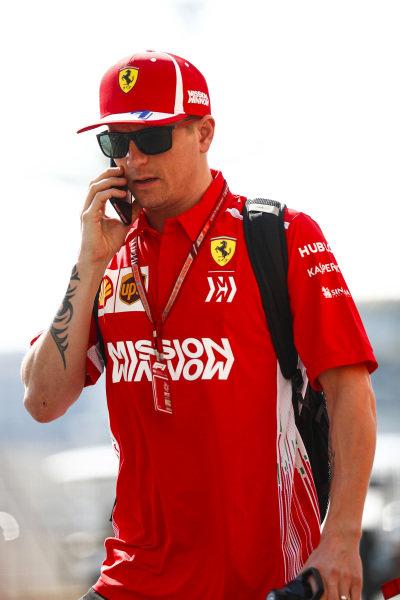Kimi Raikkonen, Ferrari, arrives in the paddock