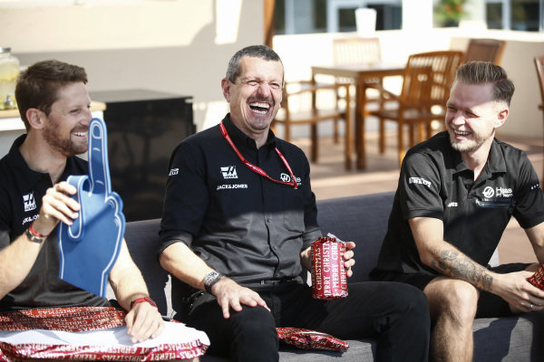 Romain Grosjean, Haas F1, Guenther Steiner, Team Principal, Haas F1 and Kevin Magnussen, Haas F1 open presents
