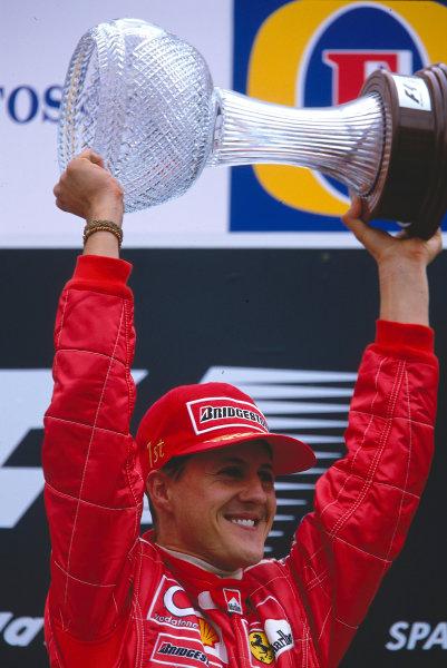 2002 Belgian Grand Prix.Spa-Francorchamps, Belgium. 30/8-1/9 2002.Michael Schumacher (Ferrari) celebrates his 1st position and record 10th Grand Prix win in a season on the podium. Ref-02 BEL 08.World Copyright - Rose/LAT Photographic