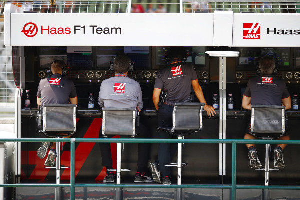 The Haas team on the pit wall.