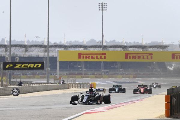 Pierre Gasly, AlphaTauri AT02, leads Carlos Sainz, Ferrari SF21, and Lance Stroll, Aston Martin AMR21