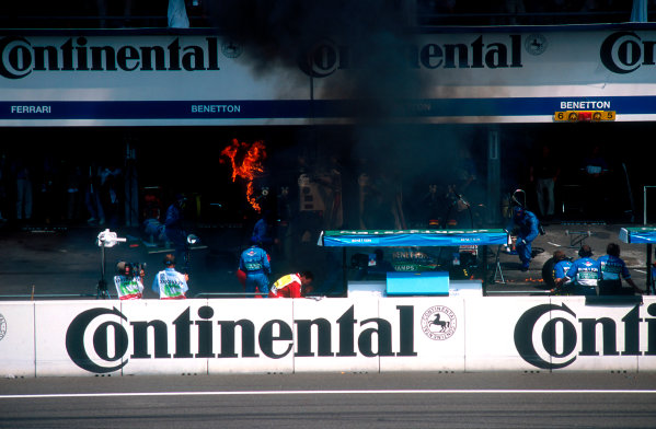 1994 German Grand Prix.Hockenheim, Germany.29-31 July 1994.Jos Verstappen (Benetton B194 Ford) came in for his pitstop. As the Refueller pulled the fuel hose away the valve stuck open allowing fuel to still come out of the nozzle and over the car which ignited into a huge fireball. The fire was delt with quite swiftly though.Ref-94 GER 47.World Copyright - LAT Photographic