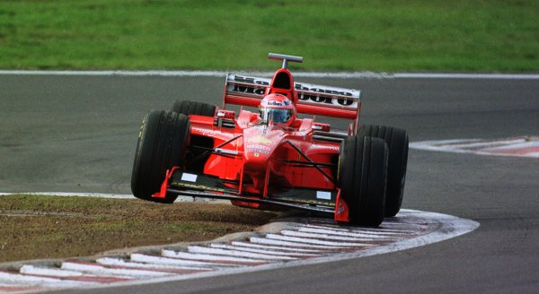 1998 Luxembourg Grand PrixNurburgring, Germany. 25-27 September 1998.Eddie Irvine (Ferrari F300) 4th position, bounces over the kerbs.World Copyright - Steve Etherington/LAT Photographic