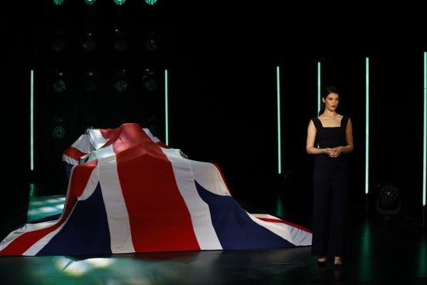 Gemma Arterton with the Aston Martin AMR21 covered by a Union Jack