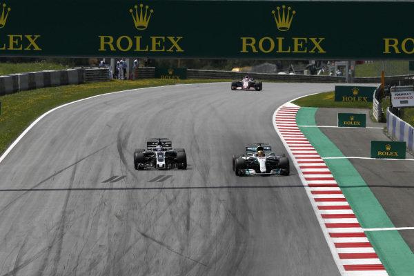 Romain Grosjean (FRA) Haas VF-17 and Lewis Hamilton (GBR) Mercedes-Benz F1 W08 Hybrid battle for position at Formula One World Championship, Rd9, Austrian Grand Prix, Race, Spielberg, Austria, Sunday 9 July 2017.