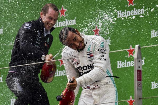 Lewis Hamilton, Mercedes AMG F1, 1st position, sprays Champagne on the podium