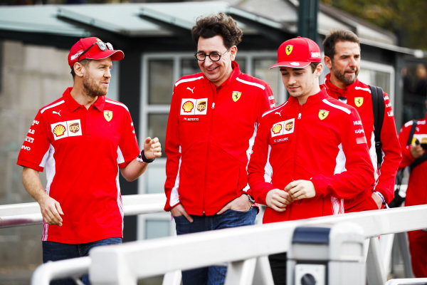 Sebastian Vettel, Ferrari, Mattia Binotto, Team Principal Ferrari and Charles Leclerc, Ferrari on the way to the Federation Square event.