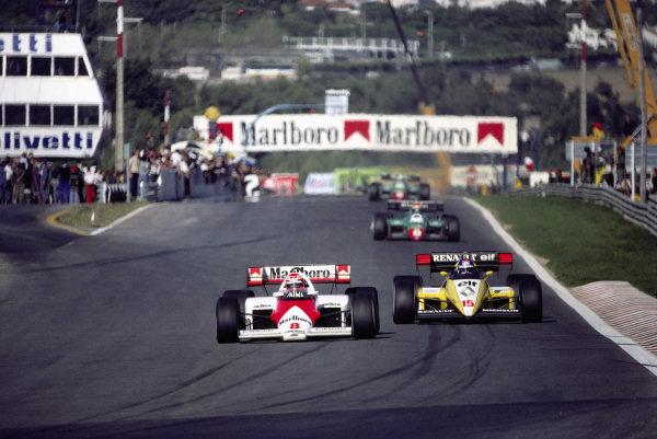 Niki Lauda, McLaren MP4-2 TAG, leads Patrick Tambay, Renault RE50.