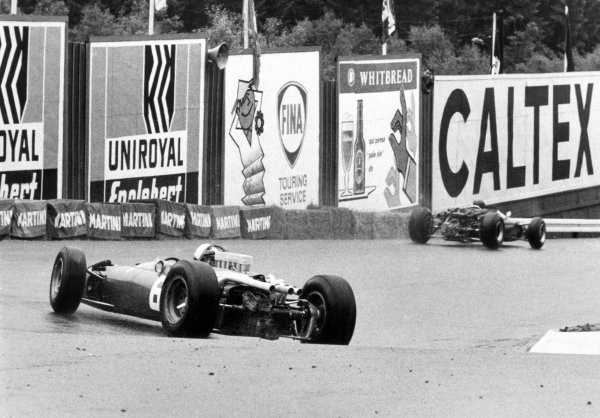 1966 Belgian Grand Prix.Spa-Francorchamps, Belgium. 12 June 1966.Jim Clark, Lotus 33-Climax, retired, leads John Surtees, Ferrari 312, 1st position, action.World Copyright: LAT PhotographicRef: b&w print